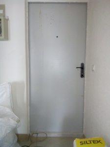 Дверь после ремонта